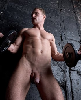 Guy working out naked and showing impressive big cock