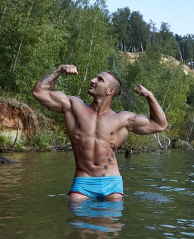 Amazing wet muscular man in speedos