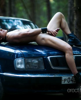 Kinky naked man on car