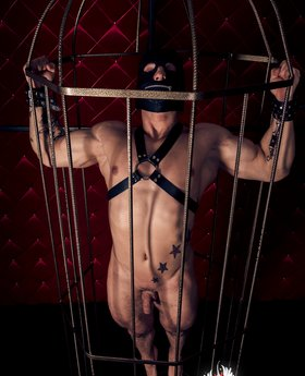 Submissive man in a cage