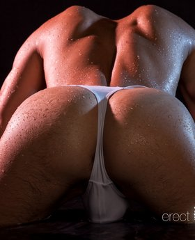 Wet guy in a thong with erecting cock
