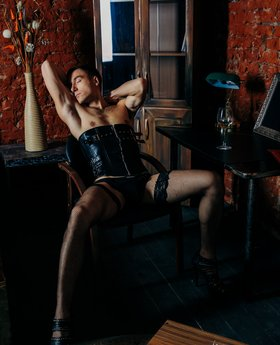 Male wearing corset and stockings