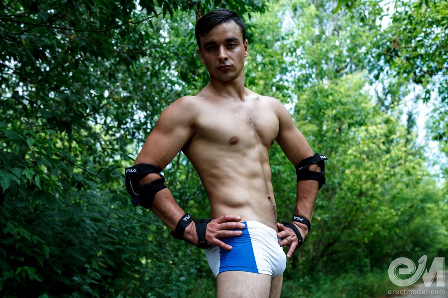Roller skates young man in lycra shorts outdoor