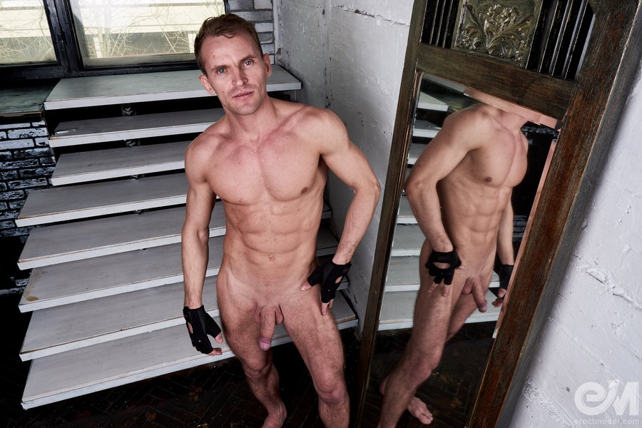 Hard huge cock of a naked man in mirror
