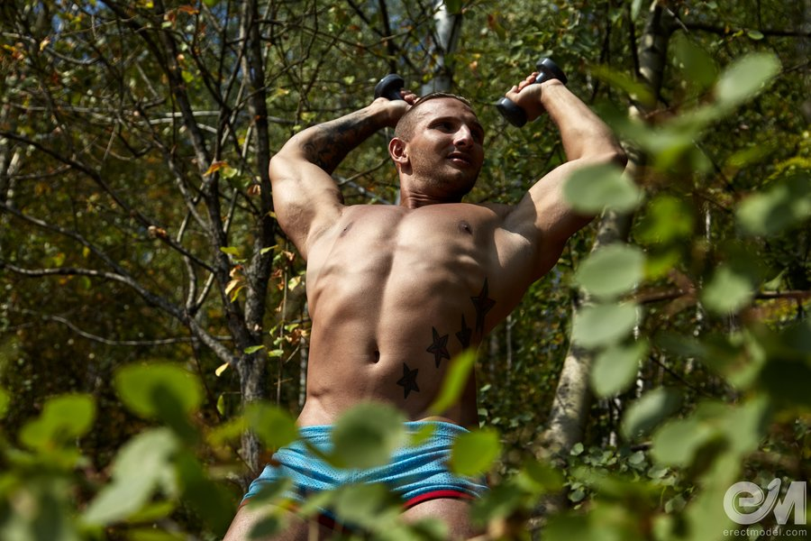 One of hottest male athletes sexy training under the trees
