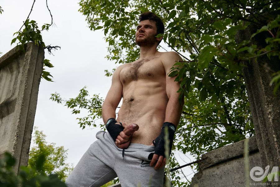 Hairy chested athlete showing his circumcised cock pics