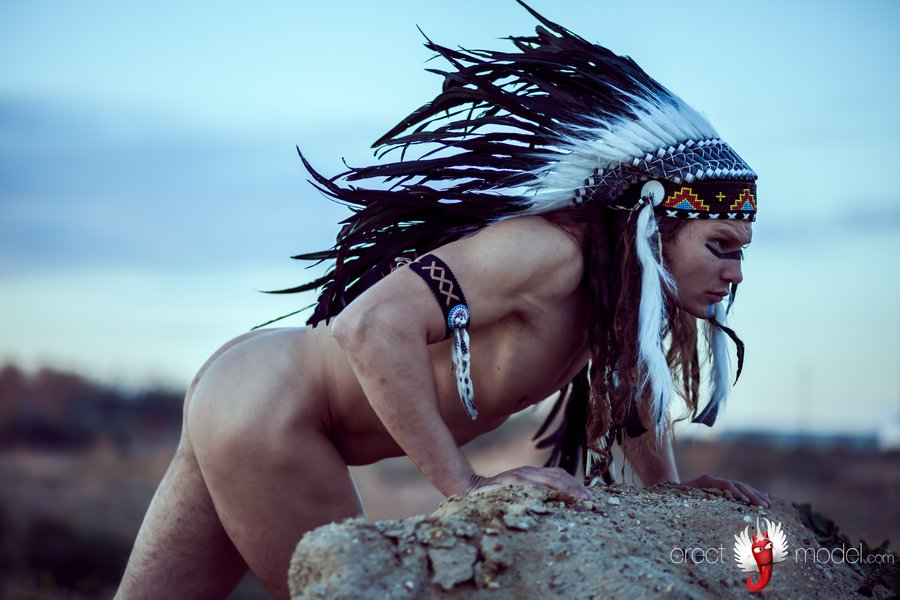 Stunning naked red Indian man alone outdoors