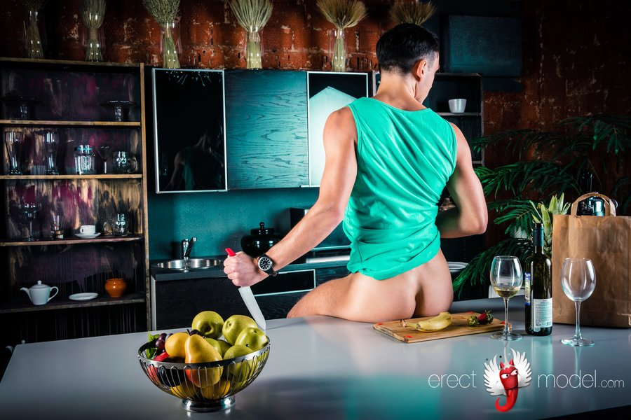 Naked man in kitchen on the cook table