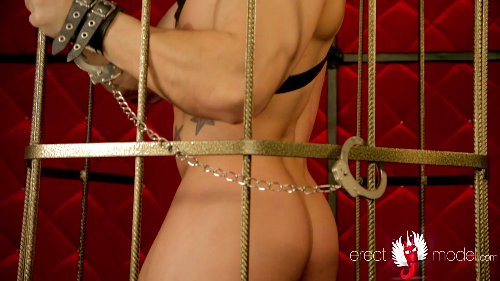BDSM man in cage