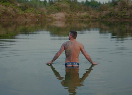 Wet uncut thick cock bathing in the water
