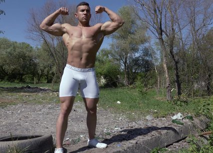 Fully nude men bodybuilder shows his big strong muscles