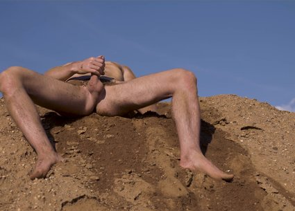 Kinky man covered in sand and his dirty penis and anus