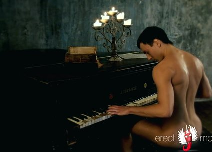 Pianist is undressing and showing his naked body on the piano